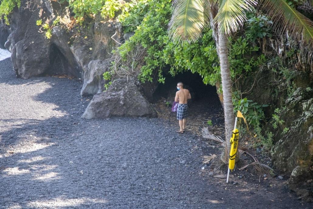 Man Into Cave Black Sand Beach