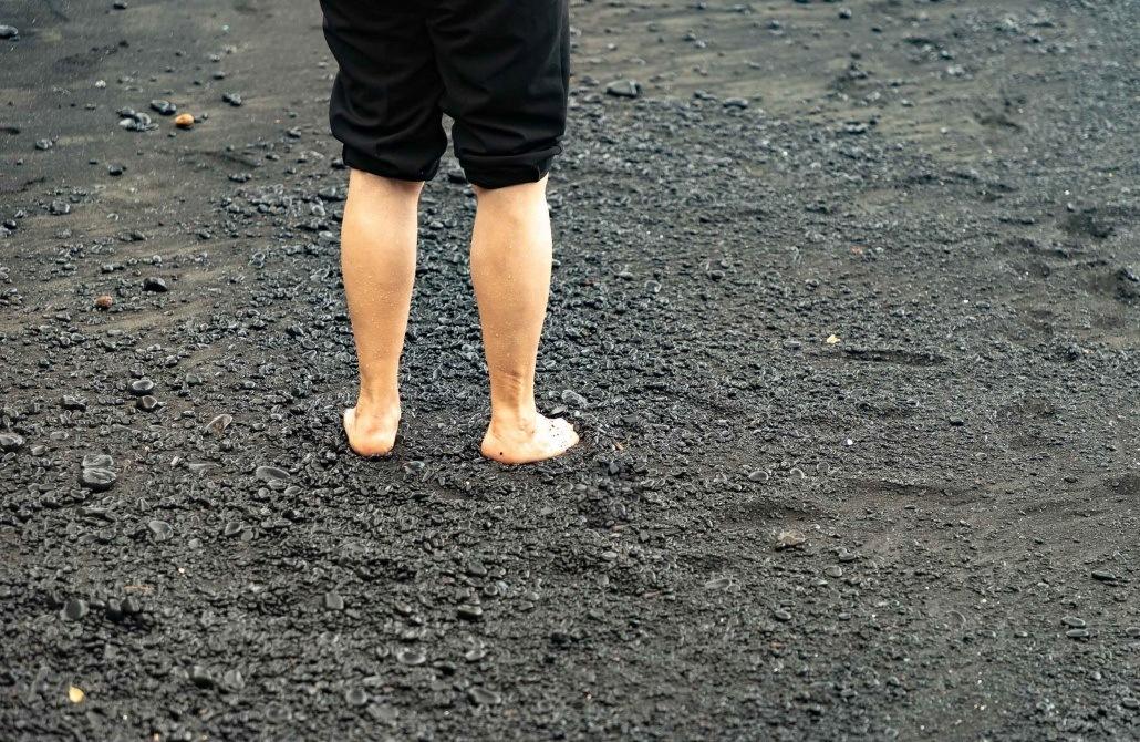 Black Sand Beach Feet in Sand Waianapanapa Road to Hana Maui
