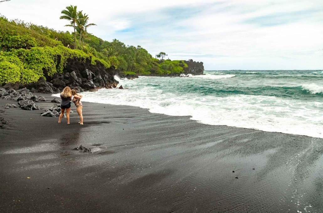 Black Sand Beach Visitors Swim Waianapanapa Road to Hana Maui