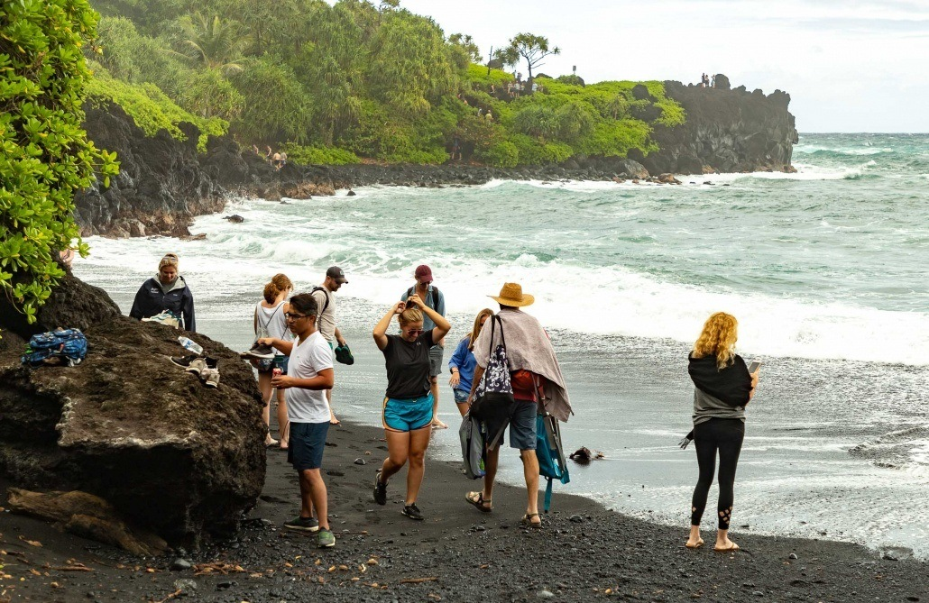 Road to Hana Black Sand Beach Visitors Walking Waianapanapa Maui
