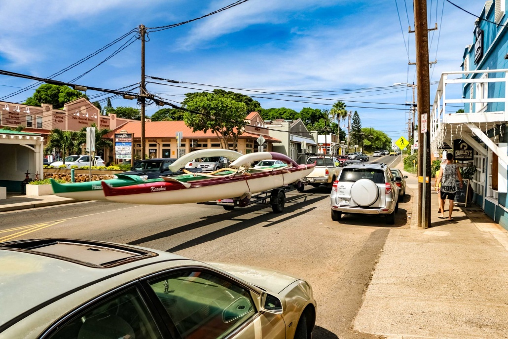 Traffic in Paia includes outrigger canoes