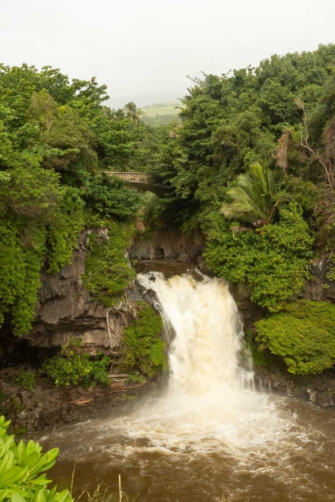 Bridge over waterfall in Haleakala National Park Kipahulu District