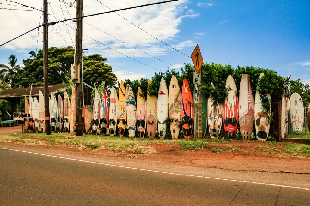 Surf boards create a fence along Hana Highway at Paia