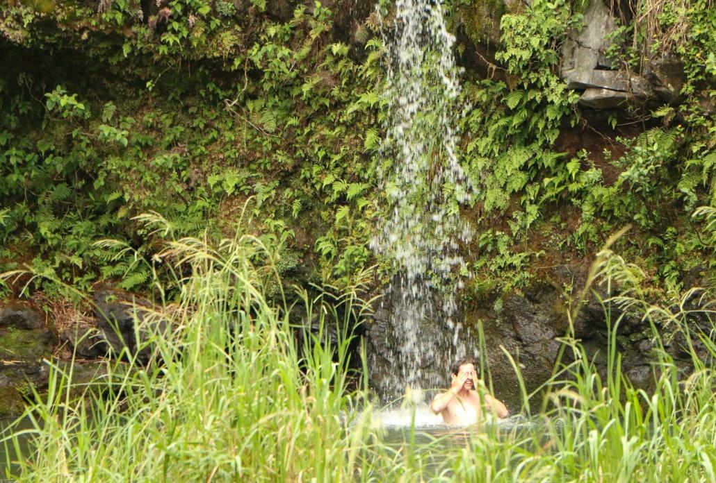 Visitor takes a refreshing swim in Hana waterfall pool