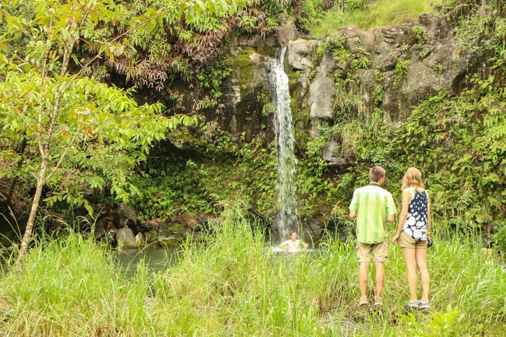 Newlyweds consider swimming in Maui jungle pool