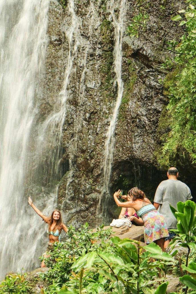 Family vacation photos under a waterfall in Hana Maui