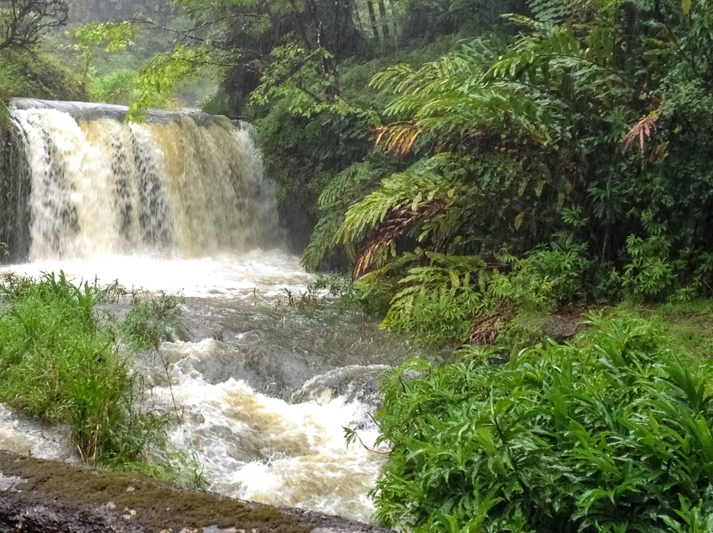 Water gushes in a Hana stream during a storm