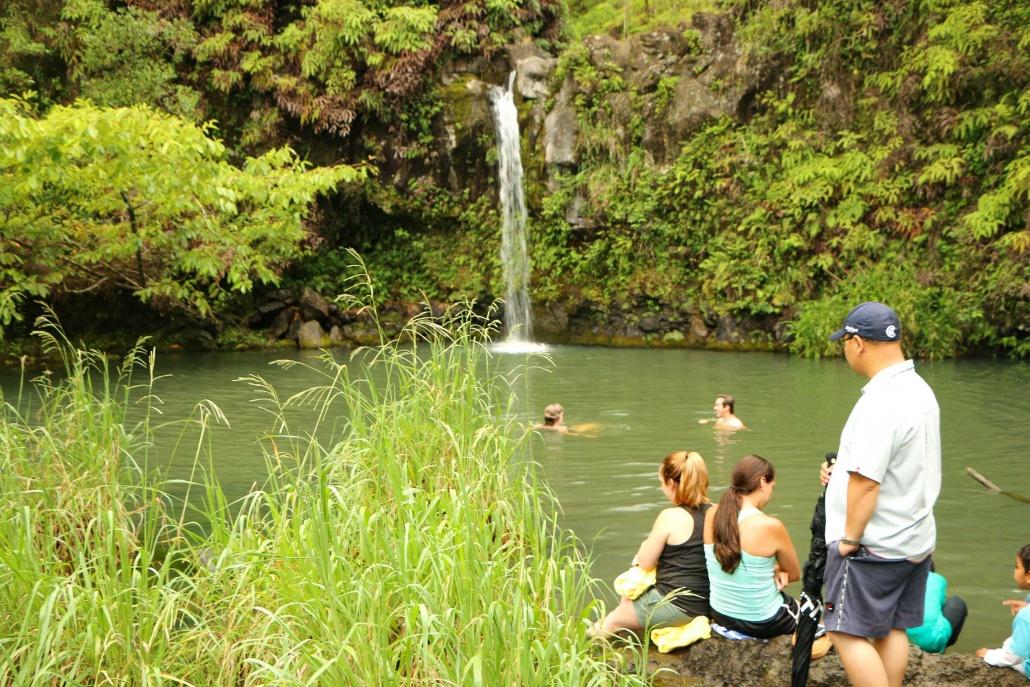 Visitors enjoy a swim in a Waterfall pool in Hana Maui